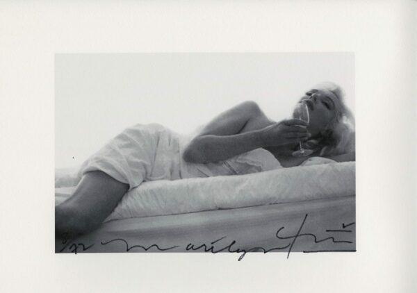 Bert Stern - Marilyn Monroe drinking wine on the bed