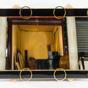 Miroir en verre noir et garniture laiton